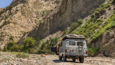 UAZ in front of rocks