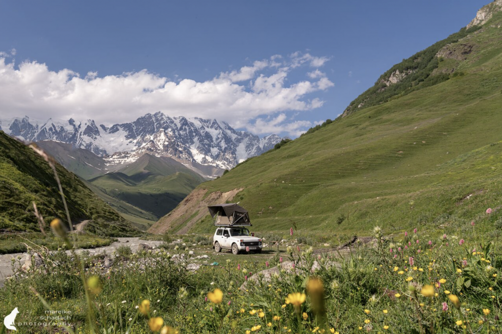 Lada Niva in front of mountains - Mareike S